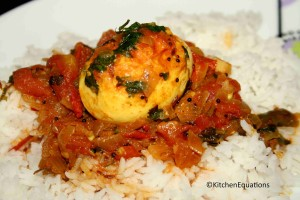 Eggs cooked in spicy tomato-onion gravy (Egg Kurma)